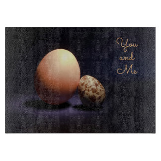 Сhicken and quail eggs in love. Text «You and Me». Cutting Board