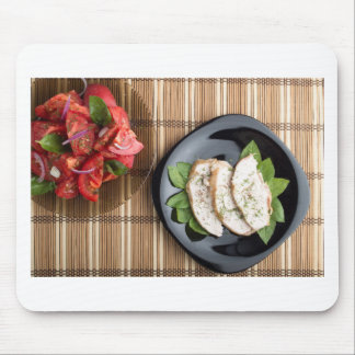 Сhicken meat decorated with basil and tomato salad mouse pad