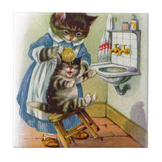 1930s kitty cat mama washes her kitten small square tile