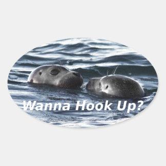 """2 Seals: """"Wanna Hook Up"""" (Making a Pass) Oval Sticker"""