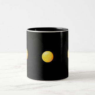 3 yellow spheres on black mugs