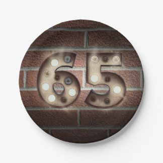 65th birthday marquee sign on brick wall paper plate