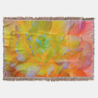 A back-lit, glowing begonia blossom throw blanket