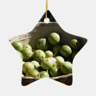 A basket full of guavas ceramic ornament