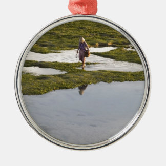 A beach scene of a villager taken in Bali island Silver-Colored Round Decoration