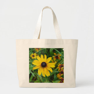 A beautiful close up of a yellow flower bag
