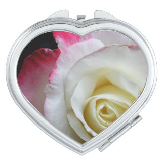A beautiful compact close up of red and white rose compact mirrors