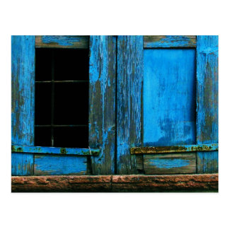 A beautiful rustic old blue window shutter Greece Postcard