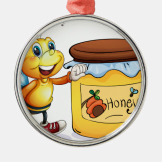 A bee beside the jar of honey metal ornament