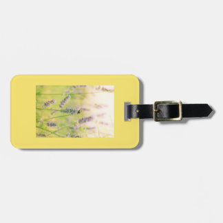 A bee on the lavender luggage tag