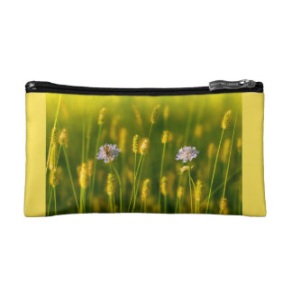 A bee on the Spring wild flowers Makeup Bag