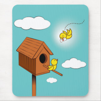 A bird carrying a love letter mouse pad
