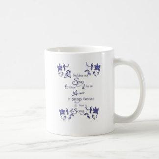 A bird does not sing because .. coffee mug