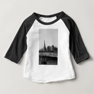 A black and white image of an old temple. baby T-Shirt