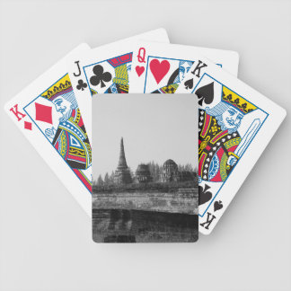 A black and white image of an old temple. bicycle playing cards