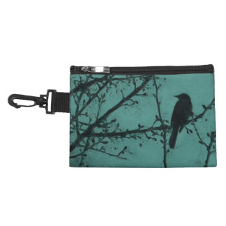 A Black Bird on a Branch with a Teal Background Accessory Bag