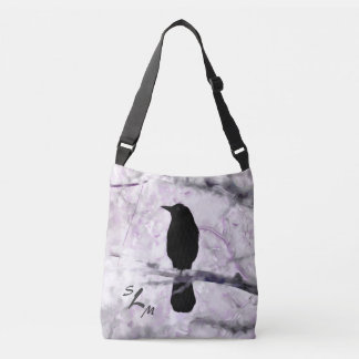 A Black Bird on a Branch with Purple, Pink and Gra Crossbody Bag