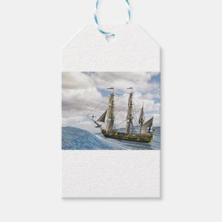 A Black Corvette Sailing Between Large Waves Gift Tags