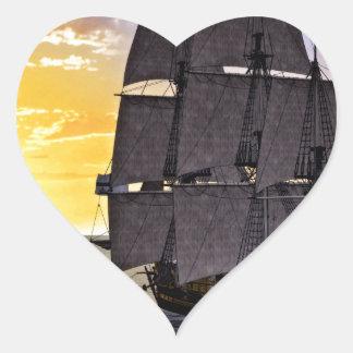 A Black Corvette Sailing Ship and the Setting Sun Heart Sticker