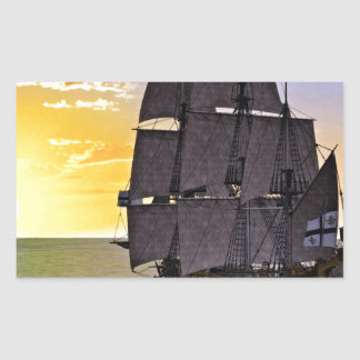 A Black Corvette Sailing Ship and the Setting Sun Rectangular Sticker