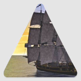 A Black Corvette Sailing Ship and the Setting Sun Triangle Sticker