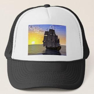 A Black Corvette Sailing Ship and the Setting Sun Trucker Hat