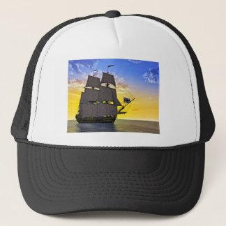 A Black Corvette Sailing Ship Before the Sun Trucker Hat