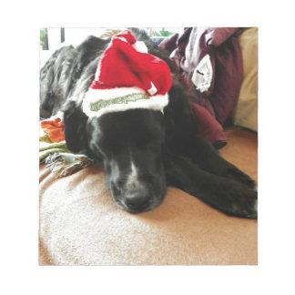 A Black Dog At Christmas with His Santa Hat Notepad