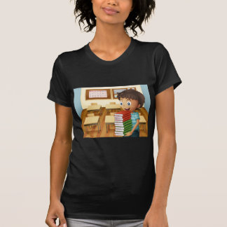 A boy carrying a pile of books t-shirts