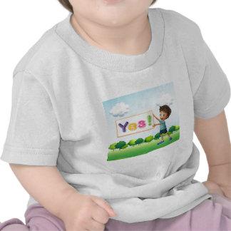 A boy holding a signboard shirt