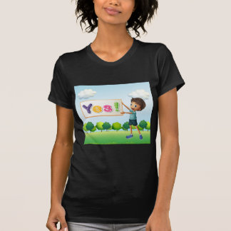 A boy holding a signboard tee shirts