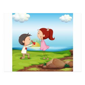 A boy making a marriage proposal at the riverbank postcard