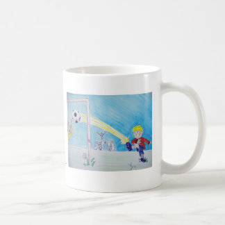 A boy's first goal playing football coffee mug