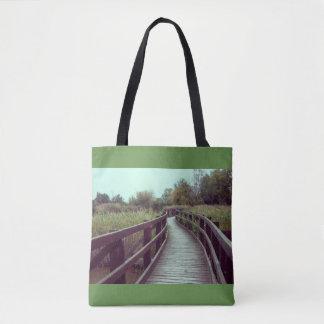 A bridge in the lagoon tote bag