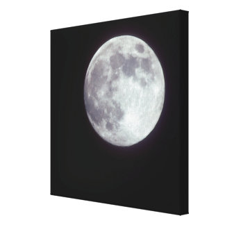 A bright full moon in a black night sky. gallery wrapped canvas