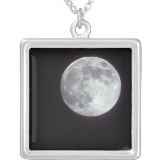 A bright full moon in a black night sky. square pendant necklace