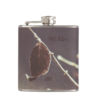 A Brown Leaf on a Gray Background in Grunge Style Hip Flask