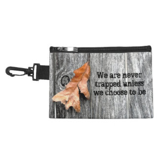 A Brown Leaf Trapped in a Gray Fence Accessory Bags