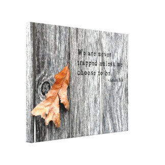 A Brown Leaf Trapped in a Gray Fence Canvas Print