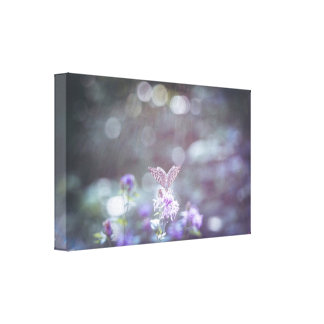 A butterfly on the wild flowers canvas print