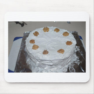 A cake with frosting mouse pad