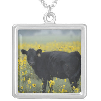A calf amid the sunflowers of the Nebraska Silver Plated Necklace