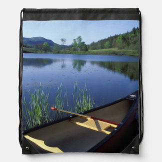 A canoe rests on the shore of Little Long Pond Backpacks