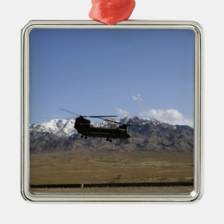 A CH-47 Chinook takes off Silver-Colored Square Decoration