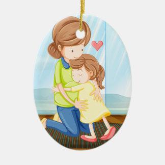 A child hugging her mother ceramic ornament