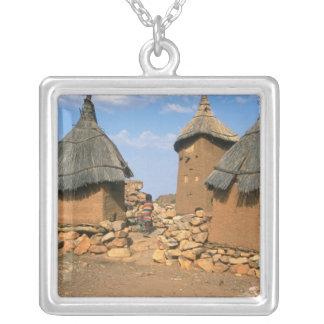 A child running through the upper Idjeli Square Pendant Necklace