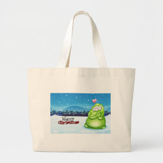 A christmas card with a green monster large tote bag