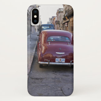 A classic old red Peugeot car parked on a street iPhone X Case