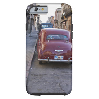 A classic old red Peugeot car parked on a street Tough iPhone 6 Case