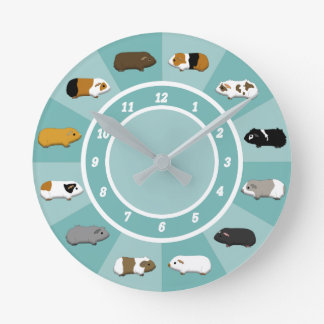 A clock with guinea pigs